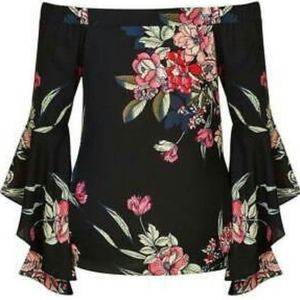 City chic off shoulder floral print top